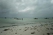 Fishermen at low tide on the east coast of Zanzibar