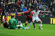Swansea city's Michu is denied by Man Utd's Tom Cleverley and keeper David de Gea. Barclays Premier league, Swansea city v Manchester Utd in Swansea, South Wales on Saturday 17th August 2013. pic by Andrew Orchard ,Andrew Orchard sports photography,