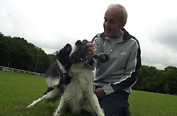 Eddie Sander with his Dogs Jackson and Inka<br /><br />18 June 2004<br /><br />Copyright Paul David Drabble<br /> [#Beginning of Shooting Data Section]<br />Nikon D1 <br /> Focal Length: 17mm<br /> Optimize Image: <br /> Color Mode: <br /> Noise Reduction: <br /> 2004/06/18 09:36:40.4<br /> Exposure Mode: Manual<br /> White Balance: Auto<br /> Tone Comp: Normal<br /> JPEG (8-bit) Fine<br /> Metering Mode: Center-Weighted<br /> AF Mode: AF-S<br /> Hue Adjustment: <br /> Image Size:  2000 x 1312<br /> 1/200 sec - F/8<br /> Flash Sync Mode: Not Attached<br /> Saturation: <br /> Color<br /> Exposure Comp.: 0 EV<br /> Sharpening: Normal<br /> Lens: 17-35mm F/2.8-4<br /> Sensitivity: ISO 200<br /> Image Comment: <br /> [#End of Shooting Data Section]