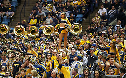 Feb 26, 2018; Morgantown, WV, USA; A West Virginia Mountaineers cheerleader performs during the second half against the Texas Tech Red Raiders at WVU Coliseum. Mandatory Credit: Ben Queen-USA TODAY Sports