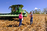 30 SEPTEMBER 2020 - WOODWARD, IOWA: KEVIN LAMBERT talks to his wife during a lunch break while combining corn on Lambert family land in Woodward. Lambert said it would take nearly twice as long to combine this year's corn compared to last year's because of damage to fields caused by the derecho wind storm that roared through central Iowa in August. The derecho wind storm damaged more than 550,000 acres of Iowa cornfields. In addition to derecho damage, Iowa farmers are wrestling with drought related damage. A persistent drought in central Iowa has stunted corn plants and reduced yields. Because of the unusually dry weather, this year's harvest is three weeks ahead of last year's and nine days ahead of average.        PHOTO BY JACK KURTZ