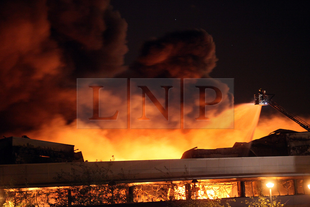 © licensed to London News Pictures. 08/08/2011. Sony Warehouse is set on fire during the riots at Enfield, North London today (09/08/2011) .  Photo credit:  Carmen Valino/LNP