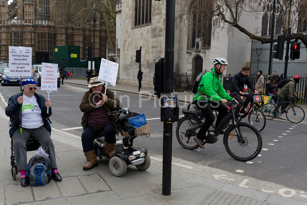 As Prime Minister Theresa May petitions European leaders in Brussels, this time to persuade the European Council to accept a delay of the UKs Brexit Article 50, disabled pro-Europeans protest outside parliament in Westminster, on 21st March 2019, in London, England.