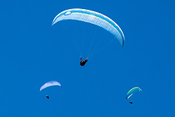 Peak District National park as Covid-19 Lockdown Eases and the Weather improves the sky close to Mam Tor near Castleton fills with paragliders <br /> <br /> 20 May 2020<br /> <br /> www.pauldaviddrabble.co.uk<br /> All Images Copyright Paul David Drabble - <br /> All rights Reserved - <br /> Moral Rights Asserted -