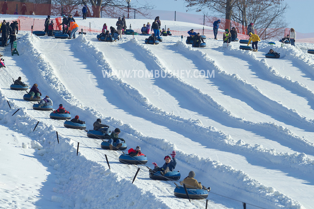 Hamptonburgh, New York - People, at left,  ride up the tow line on the snow tubing hill at Thomas Bull Memorial Park on Jan. 6, 2013.