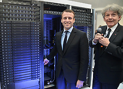 French Minister of the Economy, Industry and the Digital Sector Emmanuel Macron and Atos Chairman and CEO Thierry Breton at Loft Sevigne showroom for the presentation of Atos' Bull Sequana, the world's most efficient supercomputer, in Paris, France on April 12, 2016. A first exascale-class computer, Bull Sequana is capable of processing a billion billion operations per second while consuming 10 times less energy than current systems. Photo by Christian Liewig/ABACAPRESS.COM