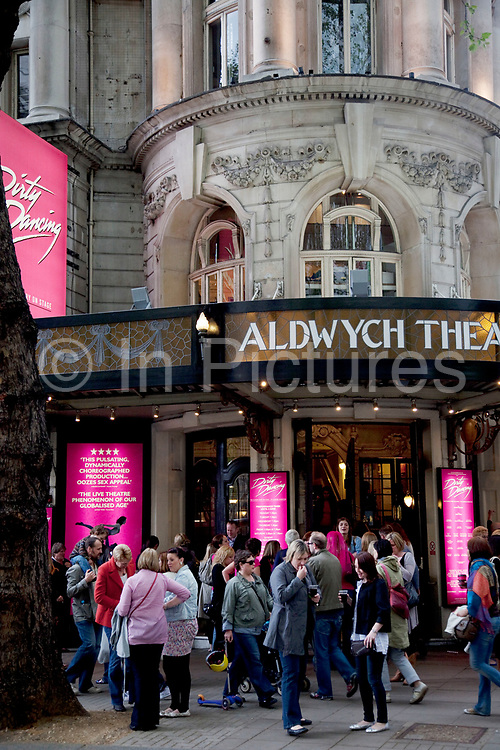 Theatre goers outside the Aldwych Theatre in Covent Garden in the West End of London. The show Dirty Dancing is showing.