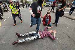 © Licensed to London News Pictures . 03/06/2017 . Liverpool , UK . An anti fascist lies in the road . Hundreds of police manage a demonstration by the far-right street protest movement , the English Defence League ( EDL ) and an demonstration by opposing anti-fascists , including Unite Against Fascism ( UAF ) . Photo credit: Joel Goodman/LNP