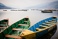 Nepal, Pokhara. Colorful boats on Phewa Lake.