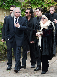 © London News Pictures. 08/06/2012. Thame, UK.  L to R Barry Gibb (brother), Robin?John Gibb (son) and Dwina Gibb (wife), leaving the home of former Bee Gee Robin Gibb on their way to St Mary's Church in Thame, Oxfordshire for the funeral of Robin Gibb on June 8, 2012. Robin Gibb died on May 20, 2012 aged 62 following a long battle against cancer. Photo credit: Ben Cawthra/LNP