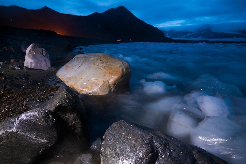 Icebergs, calved by nearby Hansbreen, line the coast below the Polar Polish Station in Hornsund, Svalbard.