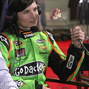 Driver Danica Patrick receives a Valentines Day flower while with the media during the NASCAR Media Day event at Daytona International Speedway on Thursday, February 14, 2013 in Daytona Beach, Florida.  (AP Photo/Alex Menendez)