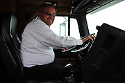 America's Road Team captain Gary Babbitt drives his truck around Dallas on Wednesday, April 3, 2013. (Cooper Neill/The Dallas Morning News)