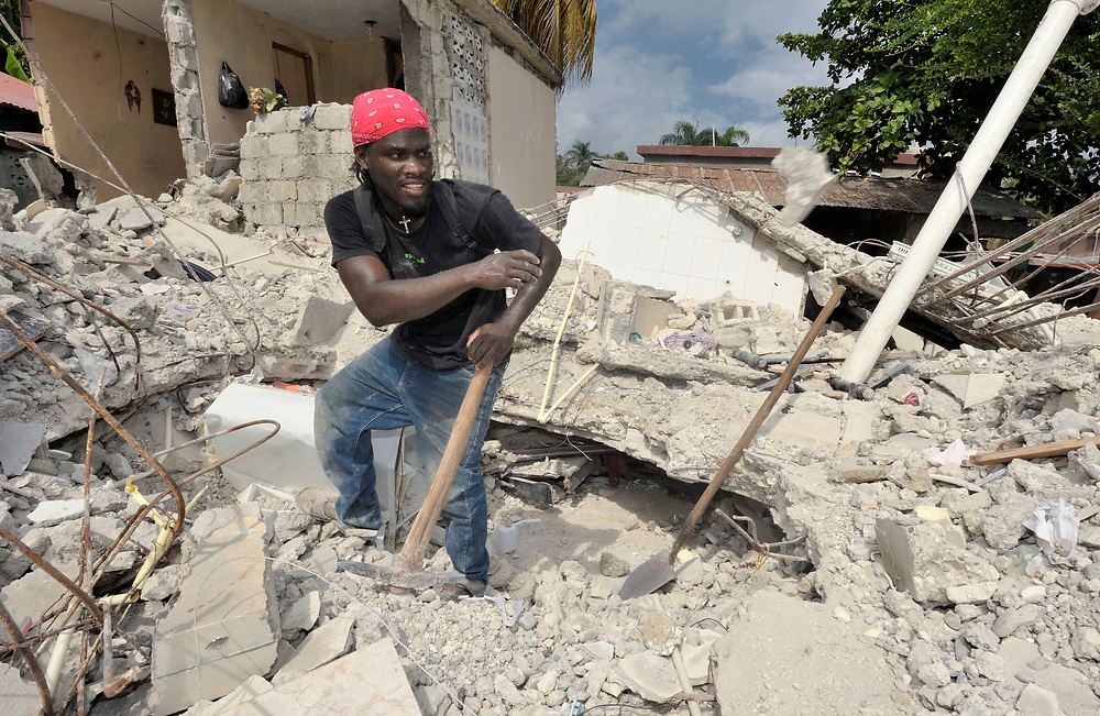 A man searches through the rubble in Jacmel, a town on Haiti's southern coast that was ravaged by the January 12 earthquake.