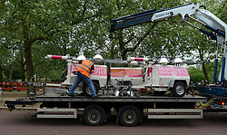 © Licensed to London News Pictures. 06/06/2012. London, UK. A man loads electrical generators onto a lorry on the Mall today 06/06/12. Workmen begin the task of deconstructing the stages and scaffolding platforms put in place for the celebrations.  The Royal Jubilee celebrations. Great Britain is celebrating the 60th  anniversary of the countries Monarch HRH Queen Elizabeth II accession to the throne this weekend Photo credit : Stephen Simpson/LNP