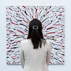 "© Licensed to London News Pictures. 19/05/2016. London, UK. A visitor looks at Mija Choi's ""Passion1601"".  Art16 opens at Olympia, in west London.  Now in its fourth edition, the fair brings together over 100 galleries from more than 30 countries showcasing a diverse cross-section of work by contemporary artists from around the world for buyers and art enthusiasts to visit. Photo credit : Stephen Chung/LNP"