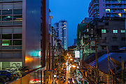 15 OCTOBER 2012 - BANGKOK, THAILAND:    Looking east down Sala Daeng Street in Bangkok at twilight. With a population of about 12 million, Bangkok is one of the fastest growing cities in the world.   PHOTO BY JACK KURTZ