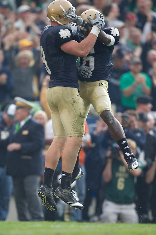 Notre Dame tight end Kyle Rudolph (#9) and wide receiver Theo Riddick (#6) celebrate fourth quarter touchdown during NCAA football game between the Notre Dame Fighting Irish and the Michigan Wolverines.  Michigan defeated Notre Dame 28-24 in game at Notre Dame Stadium in South Bend, Indiana.