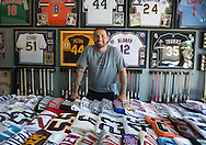 The Angels' Hector Santiago poses with part of his autograph collection during a visit to his Arizona home.