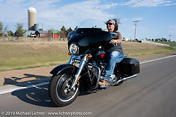 Kristin Molldrem on the Harley Owners Group (HOG) ride out from the Full Throttle Saloon during the Sturgis Motorcycle Rally. SD, USA. Thursday, August 12, 2021. Photography ©2021 Michael Lichter.