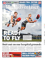 Geelong Cats footballers Joel Corey, left, and Corey Enright show their flair and athleticism while executing a diving handpass for the camera.<br /> The picture backed up the feature story during their 2009 grand final week on how they did everything together. (Copyright Michael Dodge/The Advertiser)