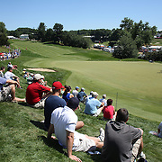 Spectators watching the golf on the first hole during the final round of the Travelers Championship at the TPC River Highlands, Cromwell, Connecticut, USA. 22nd June 2014. Photo Tim Clayton