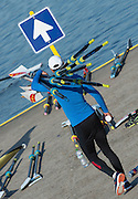 Amsterdam. NETHERLANDS. CHN M4X. Athlete carries the oars to the boating pontoon. 2014 FISA  World Rowing. Championships.  De Bosbaan Rowing Course . 08:46:47  Thursday  21/08/2014  [Mandatory Credit; Peter Spurrier/Intersport-images]