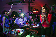 Moscow, Russia, 31/03/2012..Diners at the FAQ Cafe as carnival music band Maracatu perform.