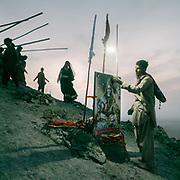 """A display of the Hindu god Shiva. The steep trek to the rim of the highest volcano is the first ritual of the Hinglaj pilgrimage. Pilgrims come up to throw a coconut in the cold mud (to thank the gods for granting their wish) and to apply the holy mud to their faces etc. The area around Chandragup (meaning """"Moon Well""""), a sacred site to Hindu of 3 mud volcanoes (mainland Asia's largest ones)."""