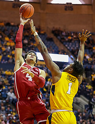 Feb 2, 2019; Morgantown, WV, USA; Oklahoma Sooners center Jamuni McNeace (4) shoots over West Virginia Mountaineers forward Derek Culver (1) during the first half at WVU Coliseum. Mandatory Credit: Ben Queen-USA TODAY Sports