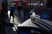 Discarded waste and litter on the top of a Bigbelly litter receptacle at Bank Underground Station in the City of London, on 22nd January 2019, in London England.