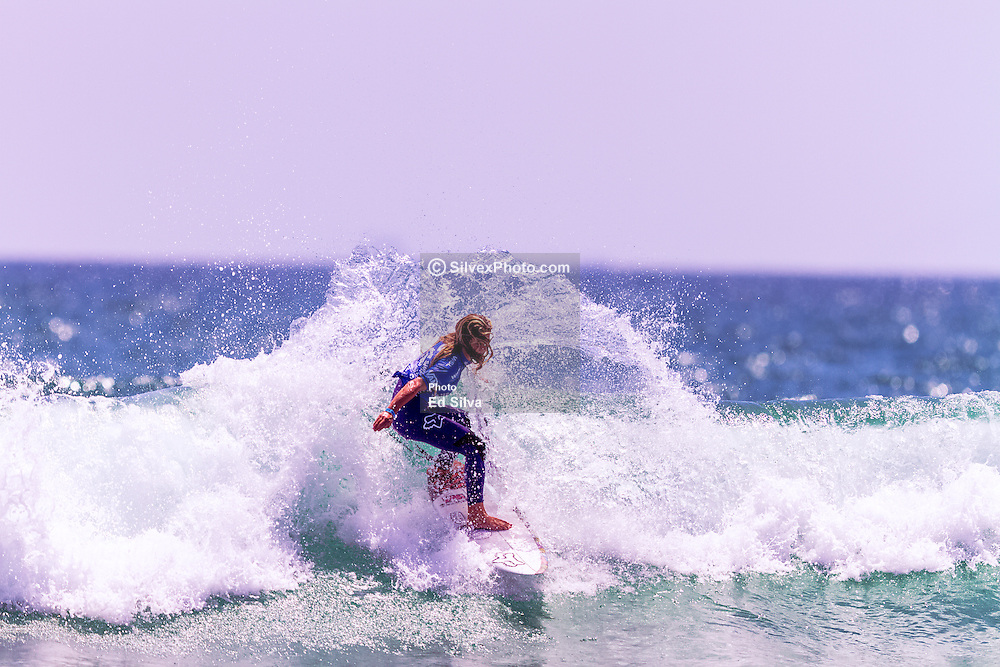 HUNTINGTON BEACH, CA - Caroline Marks (USA) has won the World Surf League (WSL) Vans US Open of Surfing Pro Junior in two-to-three foot waves at Huntington Beach Pier. Caroline Marks (USA) dominated the women's Final, starting with a 7.50 for a series of good turns and a convincing lead at the halfway mark. The 13-year-old from Florida was in rhythm with the ocean and steadily increased her scoreline throughout the heat. Two powerful turns in the pocket netted Marks a near perfect 9.43 to leave the field combed and solidify her advantage over fellow finalists Meah Collins (USA), Holly Wawn (AUS) and Frankie Harrer (USA). A last-minute 8.37 earned a final heat total of 17.80, the highest of the women's competition, and a WSL Pro Junior win for Marks. 2015 Aug 1.  Byline, credit, TV usage, web usage or linkback must read SILVEXPHOTO.COM. Failure to byline correctly will incur double the agreed fee. Tel: +1 714 504 6870.