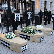 """Downing Street, London, UK. 2021-10-10. A funeral procession protest the UK government's continued refusal to break the big pharma monopolies endangering lives and prolonging the #COVID pandemic. The whole world is taking white medicine. """"Every year we see thousands of people die from diseases that the pharmaceutical industry don't invest in because they're not very profitable markets."""""""