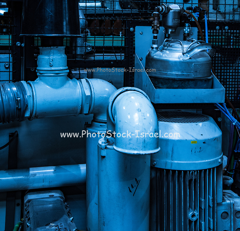 Closeup of an industrial hydraulic engine and compressor