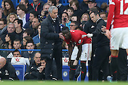Jose Mourinho, the Manchester United manager talking to Eric Bailly of Manchester United after he is injured. Premier league match, Chelsea v Manchester Utd at Stamford Bridge in London on Sunday 23rd October 2016.<br /> pic by John Patrick Fletcher, Andrew Orchard sports photography.