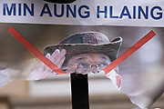 A poster showing de-facto leader of Myanmar's military government, General Min Aung Hlaing is torn in half on railings outside the country's London embassy, on 8th April 2021, in London, England. The democratically-elected government in Myanmar was overthrown by a military-led coup in February.