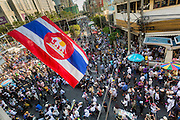 """13 JANUARY 2014 - BANGKOK, THAILAND: Anti-government protestors in the Asok intersection in Bangkok. Tens of thousands of Thai anti-government protestors took to the streets of Bangkok Monday to shut down the Thai capitol. The protest was called """"Shutdown Bangkok"""" and is expected to last at least a week. The Shutdown Bangkok protest is a continuation of protests that started in early November. There have been shootings almost every night at different protests sites around Bangkok, including two Sunday night, but the protests Monday were peaceful. The malls in Bangkok stayed open Monday but many other businesses closed for the day and mass transit was swamped with both protestors and people who had to use mass transit because the roads were blocked.    PHOTO BY JACK KURTZ"""