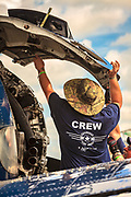 Mechanic inspects a T28 Trojan during the Sun 'n Fun airshow in Lakeland, Florida.
