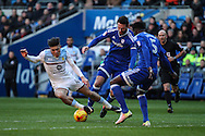 Jack Grealish of Aston Villa goes to ground, under a challenge from Sean Morrison of Cardiff City during the EFL Sky Bet Championship match between Cardiff City and Aston Villa at the Cardiff City Stadium, Cardiff, Wales on 2 January 2017. Photo by Andrew Lewis.