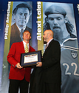 28 August 2006: Alexi Lalas (l) is presented with his Hall of Fame jacket, plaque, and ring by HOF president Will Lunn during his induction. The National Soccer Hall of Fame Induction Ceremony was held at the National Soccer Hall of Fame in Oneonta, New York.