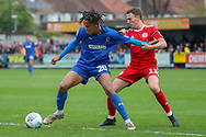 AFC Wimbledon defender Toby Sibbick (20) battles for possession with Accrington Stanley midfielder Sean McConville (11) during the EFL Sky Bet League 1 match between AFC Wimbledon and Accrington Stanley at the Cherry Red Records Stadium, Kingston, England on 6 April 2019.
