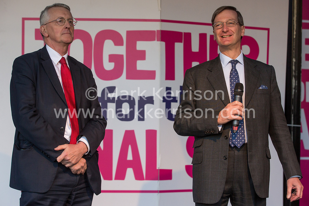 London, UK. 19 October, 2019. Dominic Grieve, Independent MP for Beaconsfield, seen here with Hilary Benn, Labour MP for Leeds Central, addresses hundreds of thousands of pro-EU citizens at a Together for the Final Say People's Vote rally in Parliament Square as MPs meet in a 'super Saturday' Commons session, the first such sitting since the Falklands conflict, to vote, subject to the Sir Oliver Letwin amendment, on the Brexit deal negotiated by Prime Minister Boris Johnson with the European Union.