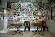 """Posters of Palestinians who died during the conflict are adorned inside a restaurant in Gaza City, April 13, 2004. Palestinians call those who died """"martyrs."""""""
