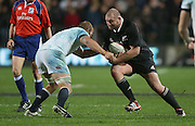 Tony Woodcock of the All Blacks on the charge against Chris Robshaw of England during the third rugby test between the All Blacks and England played at Waikato Stadium in Hamilton during the Steinlager Series - All Blacks v England, Hamiton, 21 June 2014<br /> www.photosport.co.nz