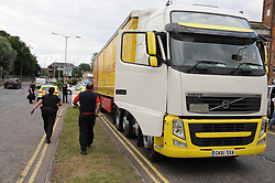 © Licensed to London News Pictures. 30/07/2015 <br /> Two illegal immigrants arrest tonight (30.07.2015) at 6pm on Mace Lace,Ashford in Kent.  Both believed to be from Iran. police found them in the back of a S/K Haulage lorry.<br /> <br /> <br /> (Byline:Grant Falvey/LNP)