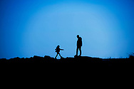 Silhouette of a man and a little girl