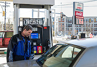 Ed Bolduc pumps gas at $1.76 at the Shop Express Laconia on Union Avenue Fridaty afternoon.  (Karen Bobotas/for the Laconia Daily Sun)