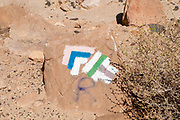 "coloured markings of nature hiking trails painted on a rock. Photographed at Makhtesh Ramon a geological feature of Israel's Negev desert. Located at the peak of Mount Negev, the world's largest ""erosion cirque"" (steephead valley or box canyons). The formation is 40 km long, 2–10 km wide and 500 meters deep, Today the area forms Israel's largest national park, the Ramon Nature Reserve."