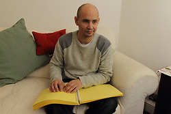 Man reading a braille document.