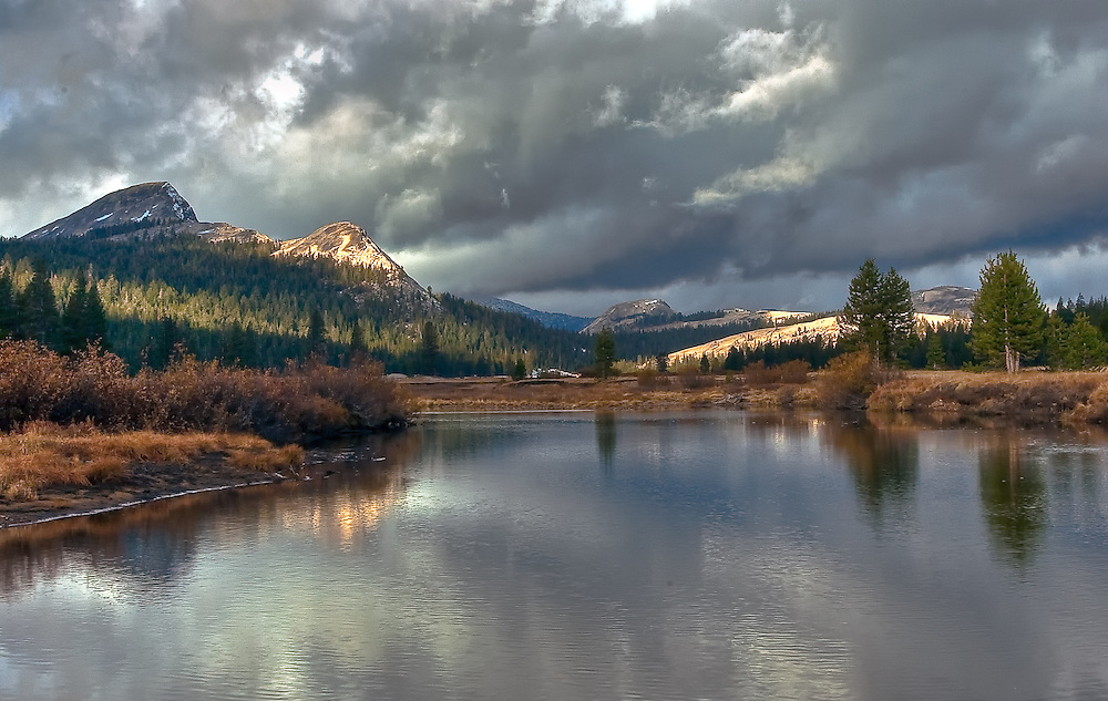 storm moving over a small lake in tuolumne meadows in the fall at yosemite national park in california